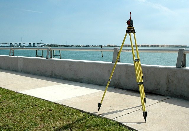 Surveying tripod on a river-side sidewalk, credit: Pixabay: 3035404