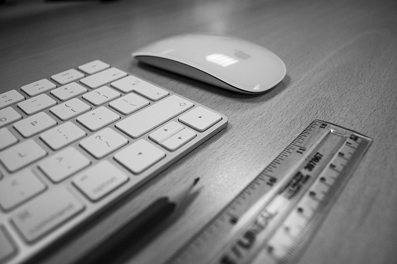 Black & white close-up of keyboard, pencil, mouse and ruler, credit: Pexels: 556565